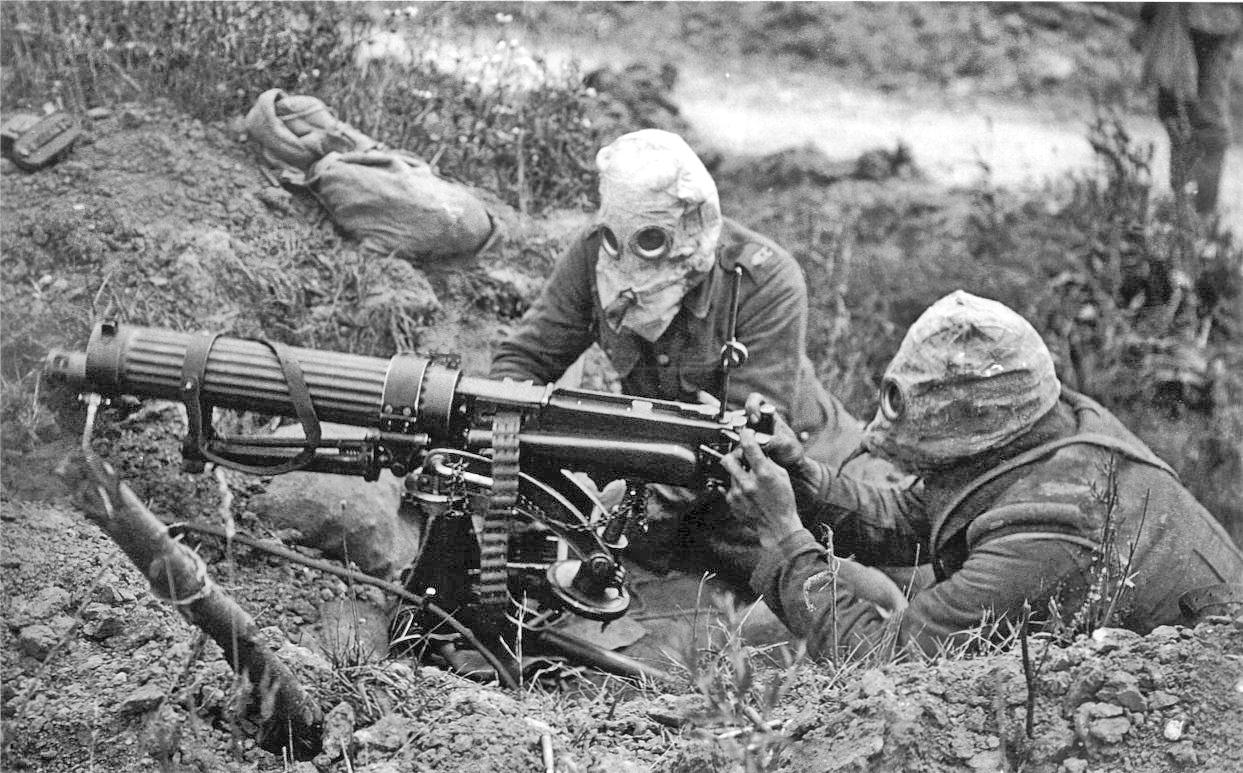 British Vickers machine gun crew wearing PH gas helmets with exhaust tubes