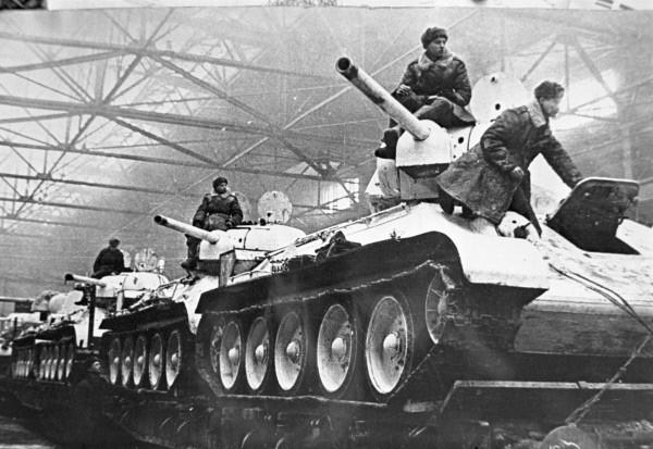 Newly built T-34 tanks being prepared for rail transport to Eastern Europe, Uralmash production facility, Sverdlovsk, Russia, 1 Feb 1942.